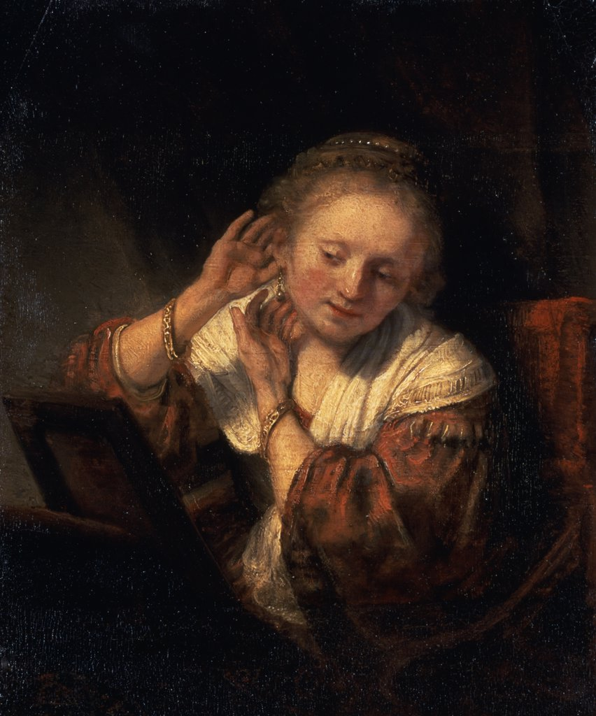 Stock Photo: 261-380 Young Woman Trying on Earrings