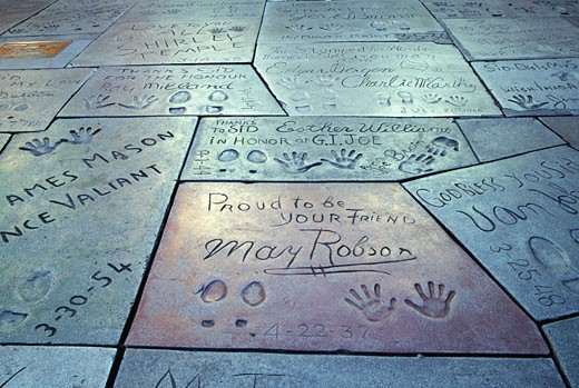 Close-up of text with handprint and footprints at a theater, Mann's Chinese Theater, Hollywood, City of Los Angeles, California, USA : Stock Photo