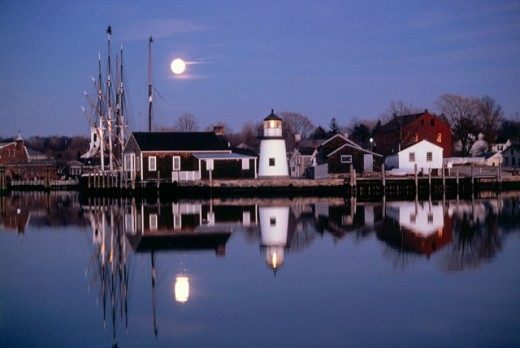 Stock Photo: 28-111D Reflection of buildings in a river, Mystic Seaport, Connecticut, USA