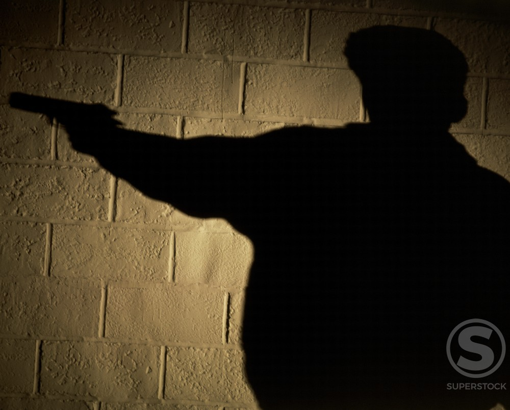 Shadow of a man on a wall : Stock Photo