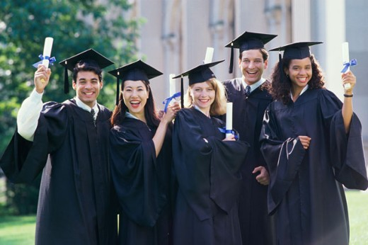 Stock Photo: 292-1048C Portrait of a group of college students wearing graduation outfits