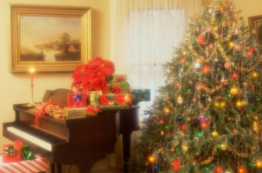 Stock Photo: 292-1923B Christmas presents on a piano near a Christmas tree