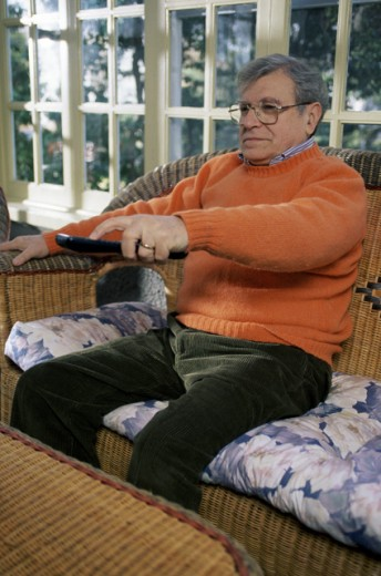 Stock Photo: 293-209A Senior man holding a remote control
