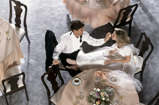 Stock Photo: 295-134A High angle view of a groom feeding cake to a bride