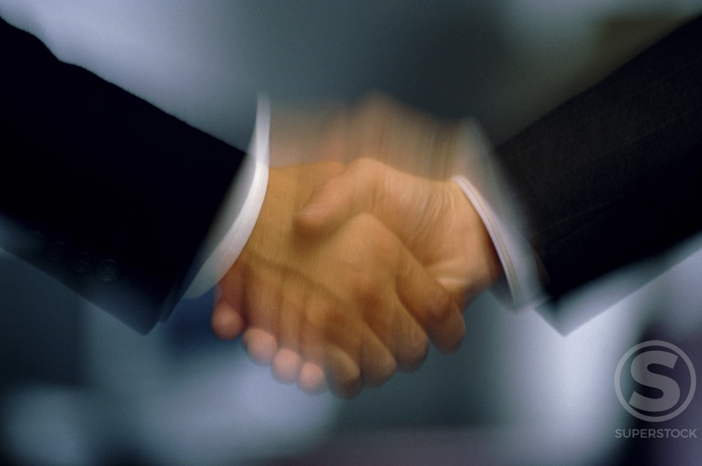 Stock Photo: 295-351B Two businessmen shaking hands