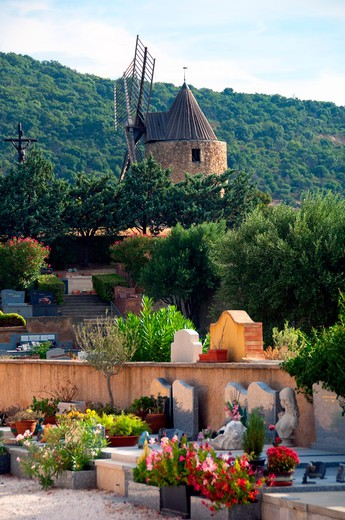 Cemetery with a windmill on hilltop, Grimaud, Var, Provence-Alpes-Cote D'Azur, France : Stock Photo
