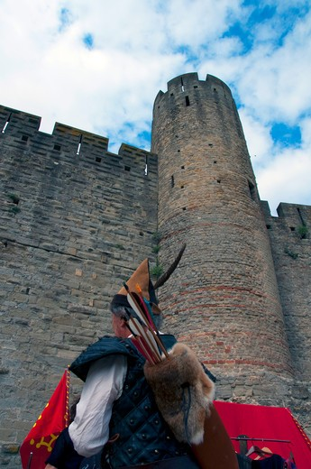 Archer in front of a fortress, Carcassonne, Aude, Languedoc-Rousillon, France : Stock Photo