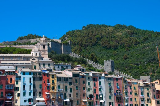 Houses and a church in a town, Portovenere, La Spezia Province, Liguria, Italy : Stock Photo