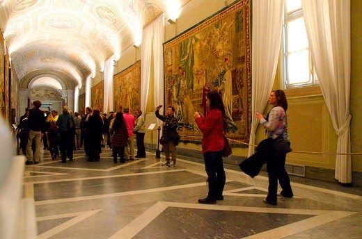 Stock Photo: 3138-537349 Tourists contemplate and photograph art works in the Gallery of Tapestries, Vatican Museums, Vatican City