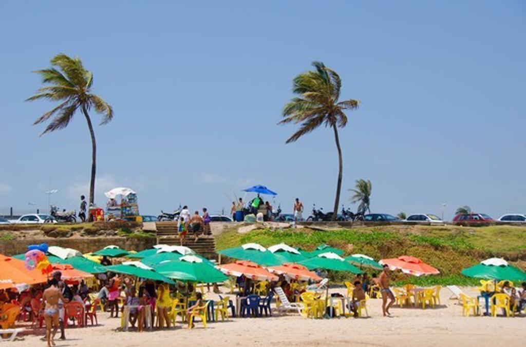 Tourists on the beach, Jaguaribe, Salvador, Bahia, Brazil : Stock Photo