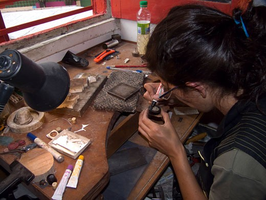 Stock Photo: 3138-715 Jeweler working on a ring in workshop, Buenos Aires, Argentina