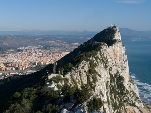 Stock Photo: 3138-780 Rock formation with a city in the background, Rock of Gibraltar, Gibraltar, Spain