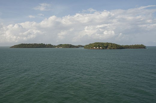 Stock Photo: 3138-854 Clouds over an island, Devil's Island, French Guiana
