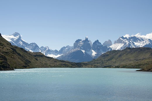 Lake in front of a mountain range, Lake Pehoe, Torres Del Paine National Park, Magallanes and Antartica Chilena Region, Chile : Stock Photo