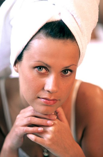 Stock Photo: 3153-576728 young woman with hair wrapped in towel