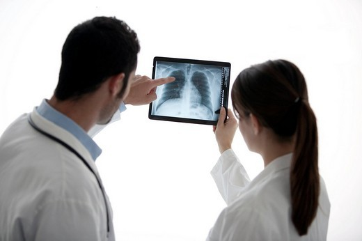 Stock Photo: 3153-577788 two doctors looking at x_rays