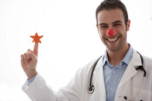 doctor, clown care : Stock Photo