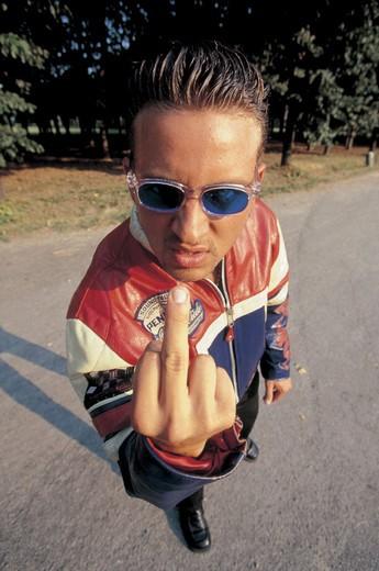 boy, rudeness, gestures : Stock Photo