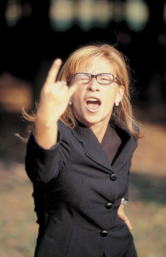 woman, rudeness, gestures : Stock Photo