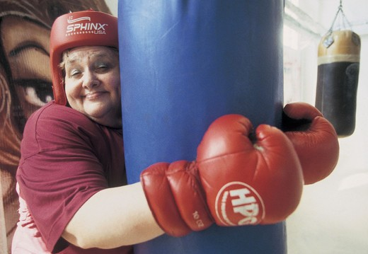 fat woman with boxing gloves : Stock Photo