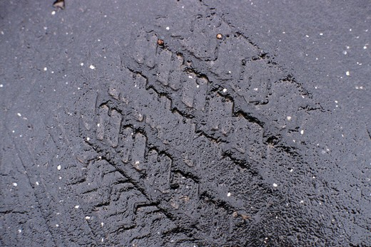 road, asphalt, trace of the wheels : Stock Photo