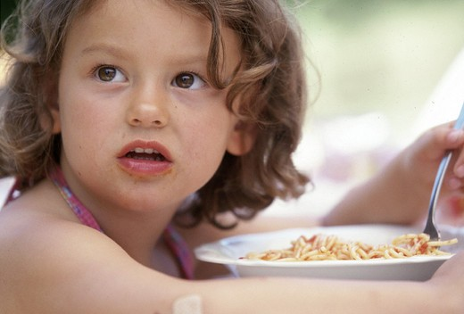 little girl eating pasta : Stock Photo