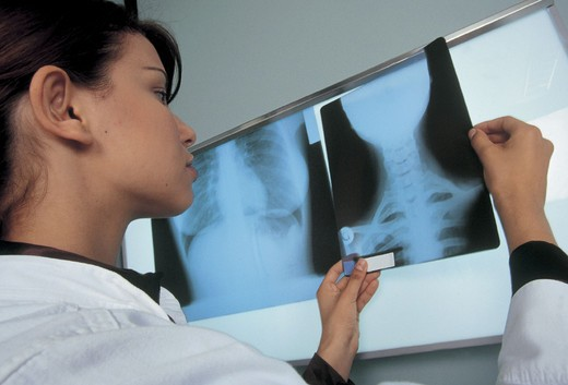female doctor with xrays : Stock Photo