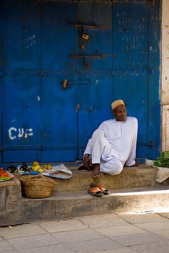 Stock Photo: 3153-622421 Fruit vendor on Blue door, Stone Town, Zanzibar Island ,Tanzania