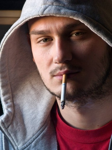 Stock Photo: 3153-625559 young man with cigarette