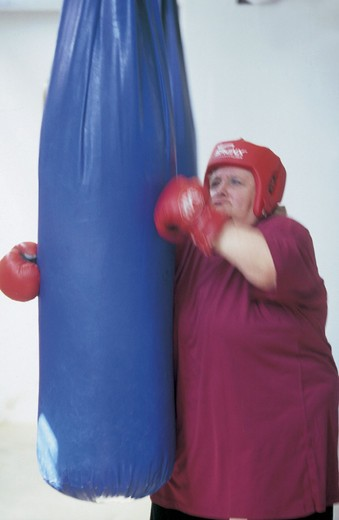 Stock Photo: 3153-627967 fat woman with boxing gloves
