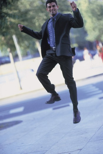 Stock Photo: 3153-633130 man jumping in the street