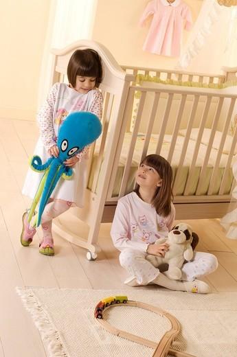 little girls with plush, pyjama : Stock Photo