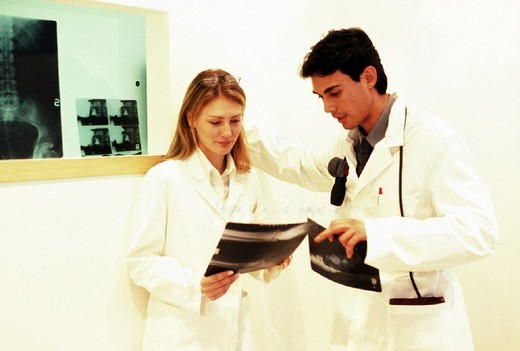 Stock Photo: 3153-635688 doctors looking at x-ray