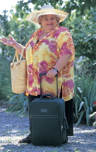fat woman with suitcase : Stock Photo