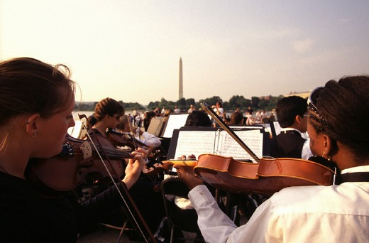usa, washington d.c., youth concert at the tidal basin with the washington monument in the distance : Stock Photo