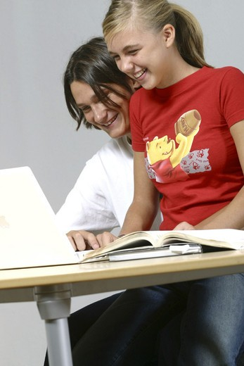 teenaged students with computer : Stock Photo