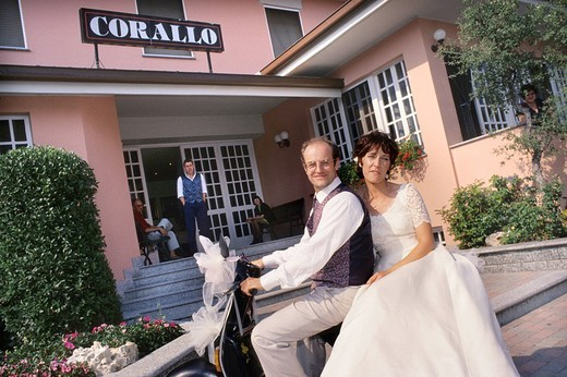 married on vespa : Stock Photo