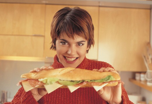 girl eat a roll : Stock Photo