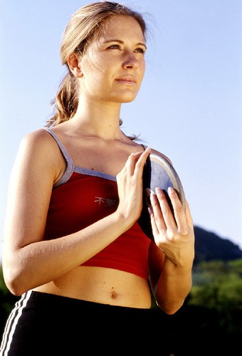 young woman, sport, throwing discus : Stock Photo