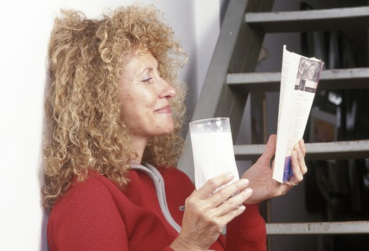 woman drinking milk : Stock Photo
