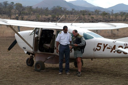 africa, kenya, campi ya kanzi, luca belpietro with the pilot of the private plain : Stock Photo
