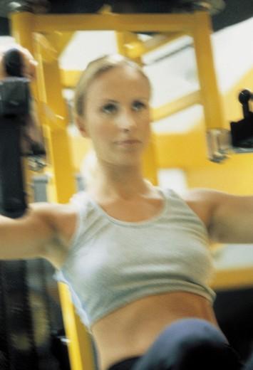 woman using the training machine : Stock Photo