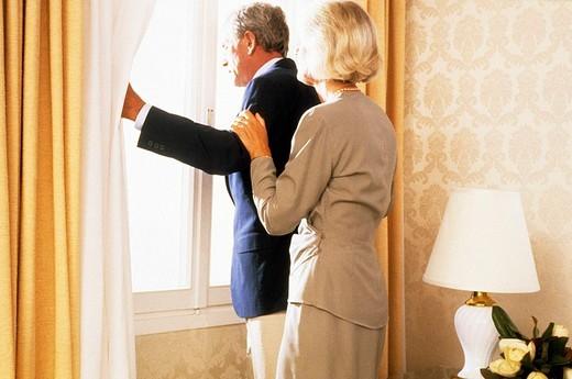 Stock Photo: 3153-654276 elderly couple at the window