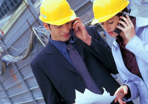Stock Photo: 3153-655231 business people with helmett, reading a plan