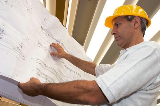 Stock Photo: 3153-656079 man reading a blueprint