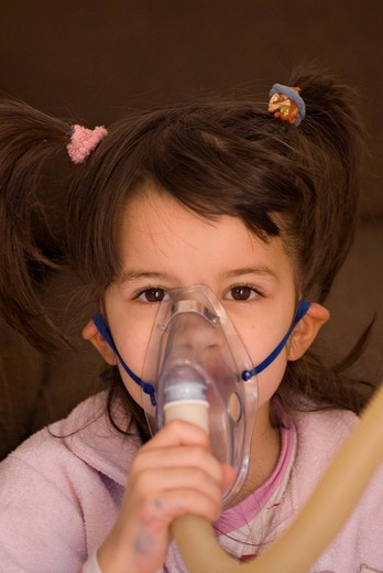 Stock Photo: 3153-658456 little girl with inhalator