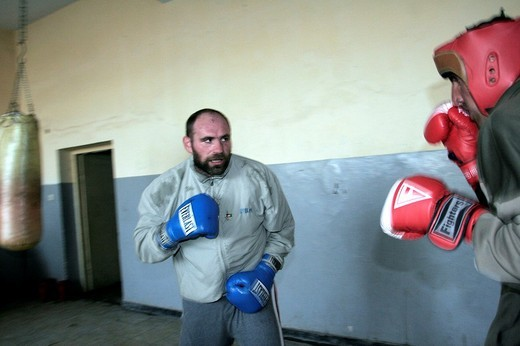 Stock Photo: 3153-663808 afghanistan, the heavyweight boxing european champion paolo vidoz during a training with the afghan national team in the olympic stadium of kabul