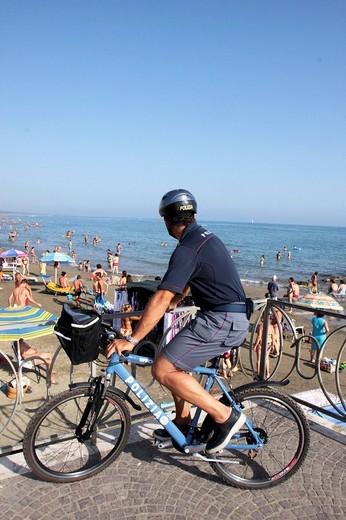 water police with mountain bike, nettuno, lazio, italy : Stock Photo