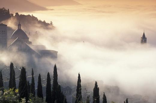 panorama/fog/st. clara church, assisi, italy : Stock Photo