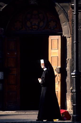 europe, poland, gdansk, a nun outside san nicholas church : Stock Photo